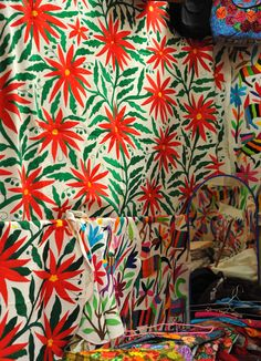 The large embroidered cloth as well as several smaller ones were made in the Otomi community of Tenango de Doria, Hidalgo state, Mexico.  They are displayed for sale in a crafts market in the city of Oaxaca, Mexico