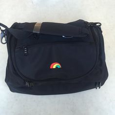 """FLASH SALE!New Rainbow Duffel!  Free SHIP Multipurpose duffel bag with rainbow logo (actually the logo of First Hawaiian Bank but no company name on the bag itself). Two main compartments with zippered pocket on top. Optional strap. Great travel or gym bag with so many uses! Length: 17"""". Bags Travel Bags"""