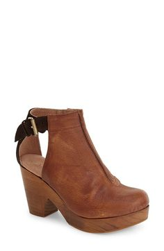 Free People 'Amber Orchard' Cutout Bootie (Women) at Nordstrom.com. Side cutouts perfect the vintage aesthetic of a Spanish-crafted bootie balanced by a wooden clog heel. A rich suede heel counter and round-toe silhouette provide a boho-chic finish.