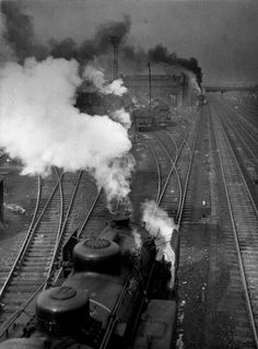 La tristesse des trains- Railways, le Bourget, France in 1946 by Robert Doisneau Robert Doisneau, Urban Photography, Street Photography, Trains, French Photographers, Train Tracks, Paris Street, Photo Archive, Photojournalism