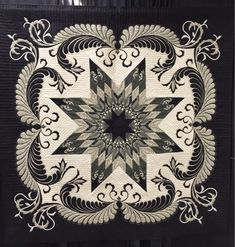 BLACK AND WHITE QUILT..........PC............... Denver National Quilt Show with my friend Michelle. We had a fabulous time! This quilt by Linda Fleschner of North Fond du Lac, WI won Best of Show. It is called Ravendale Star and the quilting and bead work make it truly spectacular.