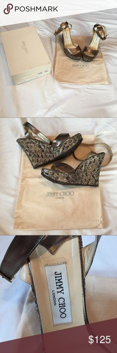 "Jimmy Choo Wedges Sparkly size 40 Jimmy Choo ""Pablo Platform Sandals"" in Gunmetal Nappa leather. Adjustable ankle strap, heel height 4.5 inches with a 1.25 inch platform. Gently used, too big for me! There is some wear on the inside part of the shoe where they rub together when you walk, as you can see in picture 2. Not noticeable when wearing. These same shoes sold on the Real Real for $245 so this is a steal! Feel free to ask any questions! Jimmy Choo Shoes Wedges"