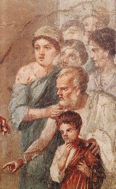 Teseo liberatore, un particolare dell'affresco. I secolo.  Museo archeologico nazionale di Napoli. Da Pompei, Casa di Gavius Rufus. Teseo ha appena ucciso il minotauro riverso a terra nell' ingresso del labirinto, e viene ringraziato dai giovinetti ateniesi destinati a finire in pasto al mostro, mentre sulla destra il popolo cretese assiste sorpreso all'evento.