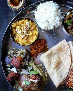 What is a Thali? It is a variety of dishes including vegetables, curries, daals, salad, sweets and a snack component on a round platter. The idea behind a thali is to serve all the different food s…