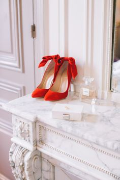 Love these red shoes with the bow!!!.