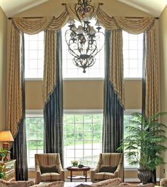 Two Story Windows: The two-story family and living rooms have become more common today. Long panels that frame the window and connect the space (from 2nd story to the floor) are the best way to add warmth to the room.  At the 2nd story level, a top treatment alone would look like it's just floating on the wall.  If light control is an issue, consider a remote controlled motorized blind, shade or shutter for that hard-to-reach window.