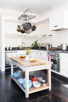 white subway tile in modern black and white kitchen. / sfgirlbybay