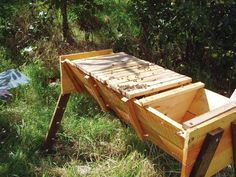 A Top-Bar Hive is an inexpensive and easy to build way to set up a one-level beehive. It is much easier to maintain than the stack of boxes seen in a typical manufactured Langstroth beehive.