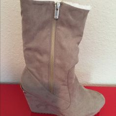 "NIB Juicy Tan suede short boot fur lined Very cute wedge boot can be worn two ways. Suede surface. Size 8 4"" wedge heel 12.5 height from sole. Retail $90 Juicy Couture Shoes Ankle Boots & Booties"