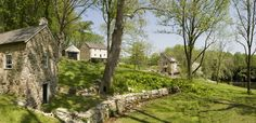 Have you always wanted to live on a farm? This lovely collection of stone house and outbuildings in West Chester, Pennsylvania, beautiful farm settings I've seen. by Archer & Buchanan Aartchitecture, Ltd. Stone Barns, Stone Houses, Stone Cottages, Decorative Stone Wall, Historic New England, Farmhouse Architecture, Classic Building, Farmhouse Landscaping, Traditional Landscape