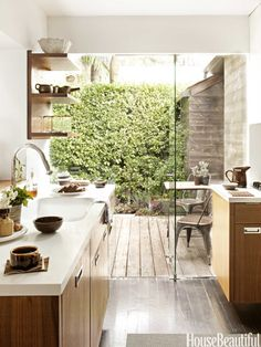 Living wall and deck matches hardwood indoors.  Also used shower doors as the exterior door!  House Beautiful. Mark Egerstrom