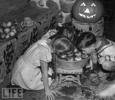 Bobbing for apples... Fun old Halloween days! (tumblr)