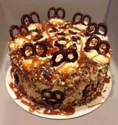 Chocolate salted caramel pretzel cake- decadent chocolate layers, filled with salted caramel frosting, crushed bittersweet chocolate coated pretzels, and homemade salted caramel.