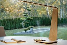The Tunto Table Lamp: A wooden lamp with touch controls and a wireless charging base for your phone or gadgets