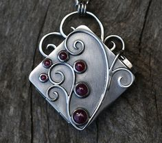 Hey, I found this really awesome Etsy listing at https://www.etsy.com/listing/225912814/the-gatherers-locket-ruby-and-sterling