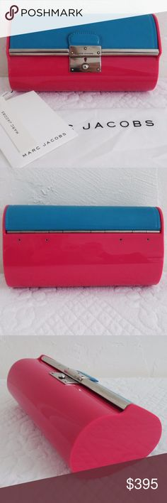 "Marc Jacobs Plexy Colorblock Clutch This beautiful pink resin and blue leather clutch is new with its tags, cards, and dust bag. About 8 1/2""W x 5""H x 3""D with antiqued silver hardware, a push-lock closure, and tan leather lined interior. The official colors are red and turquoise, but I would describe it as pink and blue. Marc Jacobs Bags Clutches & Wristlets"