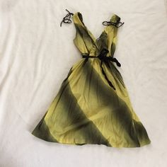 Anthropologie green dress Maeve dress, V neck in front & back, black tie around waist, side pockets, excellent condition, worn twice Anthropologie Dresses