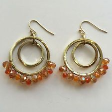 Gold plated rings and fish hooks dangling earrings with orange color f... Lot 39