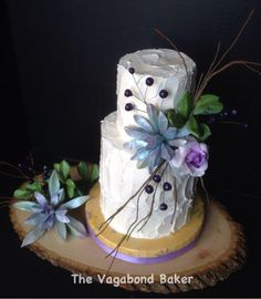 The flowers are way too big for the little cake, but the purple succulents are pretty