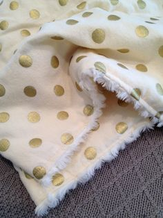 Lots of Gold Polka-Dots on Cream Flannel and Rosette Minky Baby Blanket on Etsy, $34.00