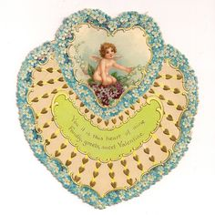 Tuck signed, Die-cut, heart-shaped card, approx. 6x6 inches, a border of forget-me-nots, image of cherub, probably by Frances Brundage, slig...