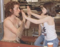 James McAvoy in costume as Mr. Tumnus on break with Georgie Henley (and her double in the background) during filming of The Chronicles of Narnia in 2004
