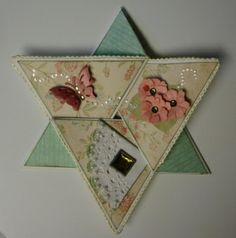 http://dailygracecreations.blogspot.com  Instructions for making this folded star card
