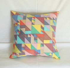 Make this gorgeous Half Square Triangle Pillow: Lovely sewing & quilting tutorial from Sew Mama Sew.