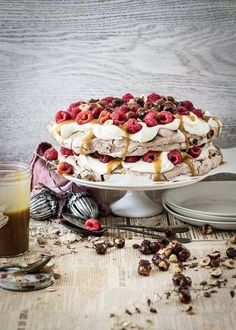 chocolate pavlova with salted caramel, whiskey sauce, raspberries & caramel hazelnuts