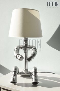 Handcrafted table lamp made from steel waterpipes.  Comes with a 180 cm long textil cord. The lampshade is not included (IKEA).  Size with shade: 18x17x47 Size without shade: 18x17x33  Bulb: E14, max 40w, 220V  Can be installed with UK or EU plug. If you can not find your country, please