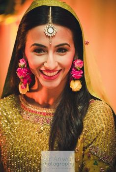 She's so pretty! And so happy. :) Check out her quirky flower jewellery too! ----- #beautiful #indian #bride