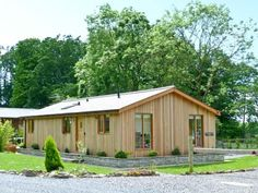 This is Westmorland Lodge in Cumbria. A perfect self catering log cabin sleeping up to four people, private hot tub & dog friendly. Log Cabin Holidays, Uk Holidays, Cumbria, Lake District, Lodges, Ground Floor, Woodland, Shed, Cottage
