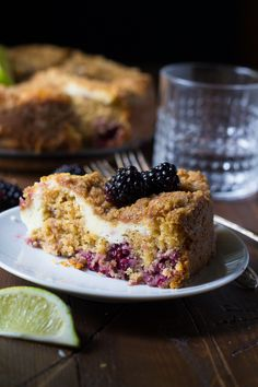 Now you'll never have to decide between coffee cake and cheesecake: two in one! Blackberry-lime coffee cake is swirled with a cheesecake layer and topped with a delicious crumb topping!