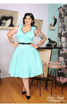 so cute! i want i want i want!....Pinup Couture Heidi Dress in Mint with black piping and belt | Pinup Girl Clothing