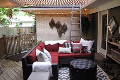 That's the Beverly 5-Piece Patio Sectional Seating Set you see in this gorgeous outdoor living room. The outdoor space was styled by designer Sam Reitmayer Sano, who completed the decor with an outdoor rug, a tufted ottoman and plenty of eclectic touches. See more of how she set up this exceptional patio on The Home Depot Blog. || @styleswoon