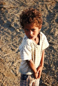 A young child from the Ababda peoples. The Abada people are the most northern Beja tribe. Now, the Abada people stay in one place and only travel tot he desert when necessary but they originally were nomadic within the Eastern Desert and Red Sea mountains in southeast Egypt.   Photo By/ Ahmed F.Gad