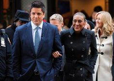 Robin Roberts, center, returns to the set of 'Good Morning America' with Josh Elliott, second left.