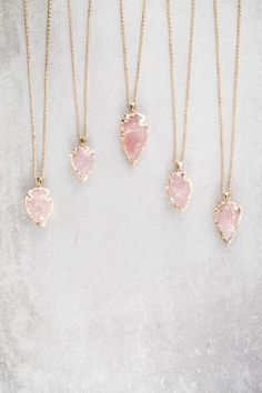 Pink arrow spearhead necklace.
