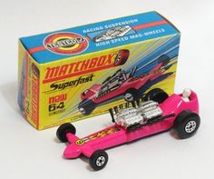 64b Slingshot Dragster with LIGHT Pink body and black base, black exhausts.
