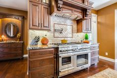 Designed by Linda Petock of Integrity Kitchen & Bath, this home in Newtown, Pennsylvania, supremely showcases StarMark Cabinetry's Prescott door style in Cherry finished in a cabinet color called Toffee with Ebony glaze. A switch up in color was introduced in the butler's pantry and the island. The same Prescott door style was used, this time in Maple finished in a color called Amaretto. Both cabinet colors connected effortlessly with neutral countertops and even-toned backsplash.