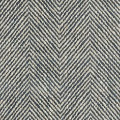 Braddock Fabric A smart herringbone weave fabric with light-reflective threads resulting in a glossy, touchable finish. Shown in denim and ivory.