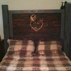"""Homemade rustic headboard, made with pallet boards. """"Always Kiss Me Goodnight"""" engraved."""