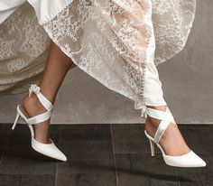 With two satin straps that you can tie around your ankle, our new 'Colette' style is super flattering. We have used the softest ivory suede to create these ballet inspired bridal shoes, and the slim 80mm straight heel is both stylish and practical, making the 'Colette' style a joy to wear on your big day. Read more on our blog. Click the image to explore Satin Wedding Shoes, Designer Wedding Shoes, Wedding Heels, Bridal Wedges, Bridal Sandals, Ribbon Shoes, London Brands, Bride Shoes, Vintage Glamour