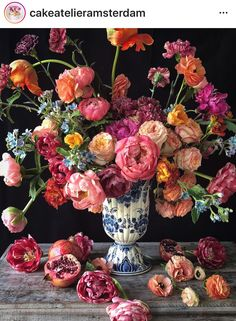 This stunning bouquet of roses, peonies, carnations, and more took our breath away. Floral arranging truly is an art form! Real Flowers, Amazing Flowers, Beautiful Flowers, Sugar Flowers, Purple Flowers, Beautiful Flower Arrangements, Floral Arrangements, Flower Power, Blue And White Vase
