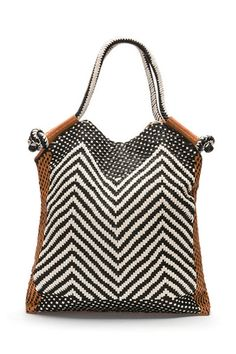 25d8df0301  510 Woven leather Kathy Cabas bag by Antik Batik. Features magnetic  closure