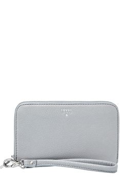 """Crafted of smooth glazed leather, Fossil's chic zip phone wallet is a classic she'll want to carry all season long—and for seasons to come. This wallet is large enough to hold an iPhone® 4/4s, iPhone® 5, iPhone® 6, and Samsung Galaxy S4®. Inside has 3 credit card slots, 2 gusseted pockets, 1 media pocket, 1 slip pocket. Outside has 1 zipper pocket, zipper closure, and a wristlet strap.    Measurements: 6.25""""L x 0.75""""W x 3.75""""H   Zip Phone Wallet by Fossil. Bags - Wallets & Wristlets Omaha…"""