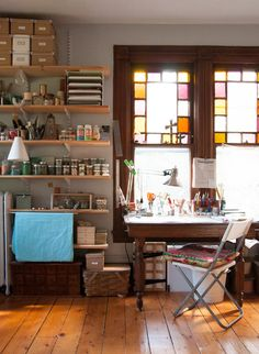 Image above: Darbie loves that her studio desk looks out over their street, because it's lined with beautiful Victorian homes.