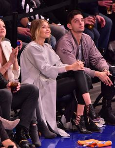 Sitting court-side at a New York Knicks game wearing a taupe trench coat, black leggings and sky-high stilettos.    - MarieClaire.com