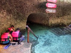 Snorkeling in the crystal clear waters of the underground river at Xcaret in Cancun, Mexico