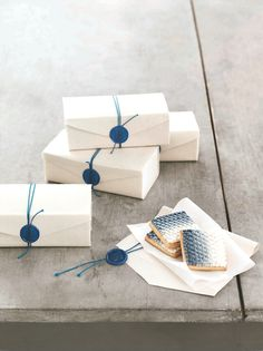 Blue wax seals with blue twine on white canvas box - lovely clean packaging